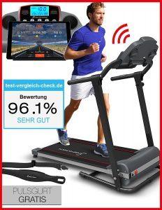 Mann beim Training auf Laufband Sportstech F10 schwarz