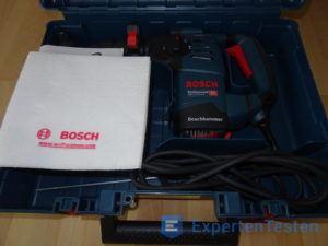 Anleitung und Aufbewahrungskoffer mit Bohrhammer von Bosch