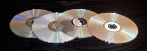 DVD-Player vier aufeinanderliegende DVDs