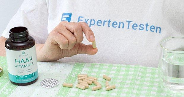 SOLVISAN Haar Vitamine im Test - Gebrauchsanweisung: Täglich zwei Kapseln unzerkaut mit ausreichend Wasser einnehmen