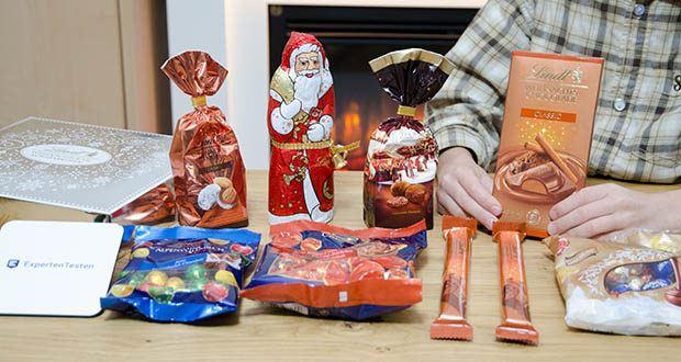 Lindt Weihnachtliche Kostbarkeiten Schokoladengeschenk im Test - Inhalt: 1x Weihnachtsmann Vollmilch 125 g, 2x Weihnachts-Chocolade-Sticks je 39 g, 1x Gebrannte Mandeln 100 g, 1x Weihnachtsmandeln 100 g, 1x Cresta-Baumbehang 100 g, 1x Weihnachts-Chocolade 100g, 1x Lindor Mini-Kugeln-Mix 180 g, 1x Alpenmilch-Mini-Kugeln 100 g
