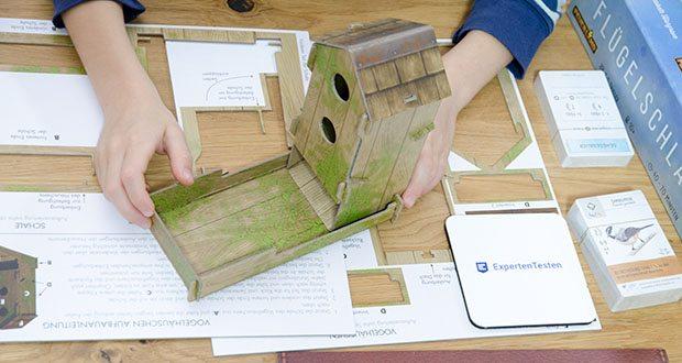 Feuerland Spiele Flügelschlag Brettspiel im Test - eine hochwertige Austattung wie der Würfelturm in Form eines Vogelhäuschens und die massiven Vogeleier runden das Spielerlebnis perfekt ab