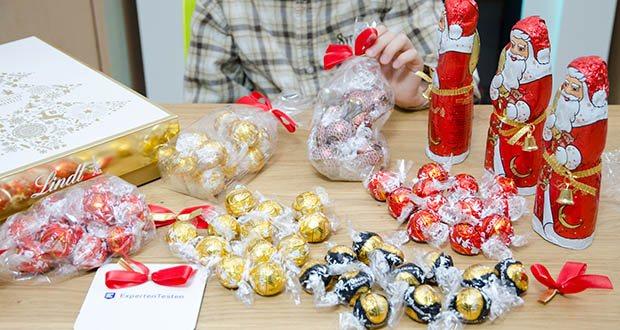 Lindt Weihnachts-Schokolade Schokoladengeschenk Gold im Test - eine ausgewählte Mischung LINDOR-Kugeln (Dark 70 Prozent, Vollmilch, Lebkuchen, Weiß) und Vollmilch-Weihnachtsmänner