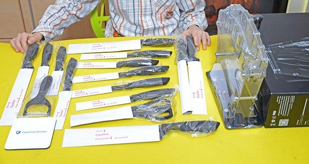 Deik Messerblock Set im Test - Lieferumfang: 1x Teiliges 20.3cm Kochmesser, 1x Teiliges 20.3cm Tranchiermesser, 1x Teiliges 20.3cm Brotmesser, 1x Teiliges 20.3cm Wetzstahl, 6x Teiliges 11.5cm Steakmesser, 1x Teiliges 15.3cm Santokumesser, 1x Teiliges 12.7cm Allzweckmesser, 1x Teiliges 9cm Schälmesser, 1x Teiliges 9cm Schäler, 1x Teiliges 12.7cm Vielzweckschere, 1x Teiliges Acryl Messerhalter