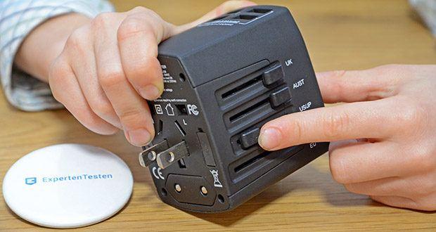 Welt-Reiseadapter mit 4x USB-Ladegerät im Test - schieben Sie den jeweiligen Schalter für Ihr Land heraus